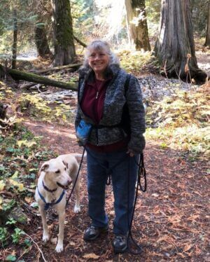 Woman Debra Duwe and dog hiking